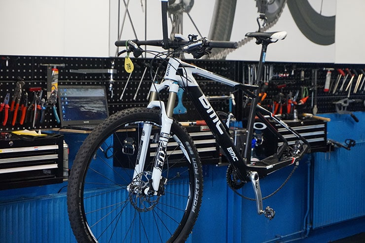 a BMC mountain bike in maintenance