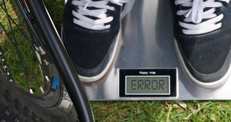 weight scales and a mountain bike