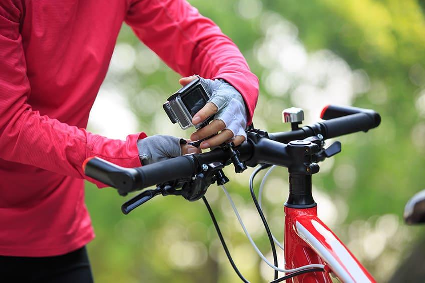 Mountain biker attaching a camera to handlebar.jpg